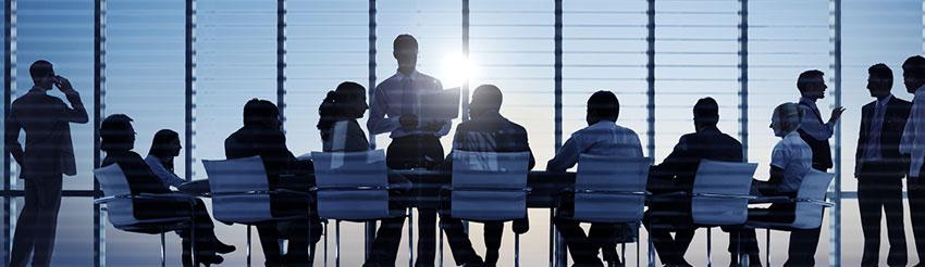 εικόνα επαγγελματικής συνέλευσης από το header της σελίδας ασφάλισης μεγάλων επιχειρήσεων